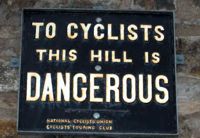 Photo of a NCU/CTC sign reading: To Cyclists this hill is dangerous