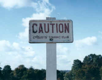Photo of a vintage CTC Caution road sign