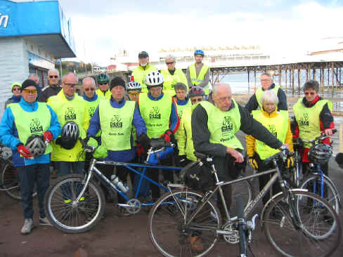CTC Cymru riders stand in silent memory before starting their Wednesday ride