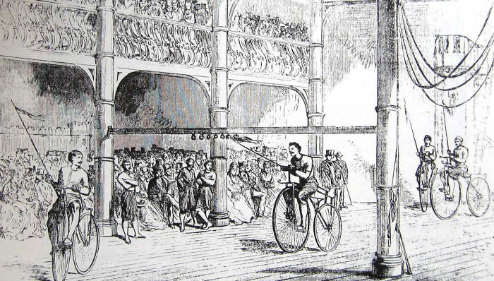 Drawing of cyclists with long lances tilting at a hanging target before a large crowd