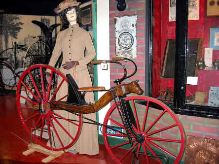 19th century hobby horse bicycle with model of lady in costume