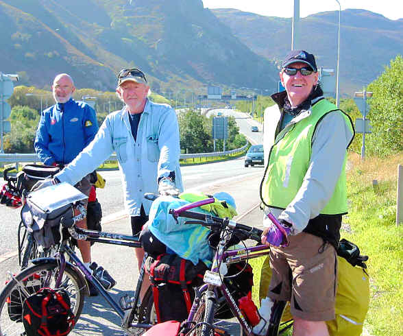 Three touring cyclists on the cycle path adjacent to the A55 near Penmaenmawr