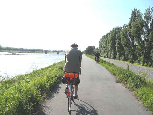 Harry Watson cycling on the path alongside the River Dee