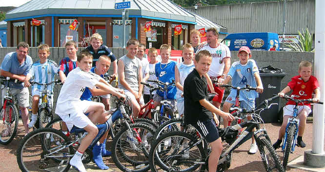 Young members of Conwy Borough Football Club at Penmaenmawr Beach Cafe on a sponsored ride to raise funds