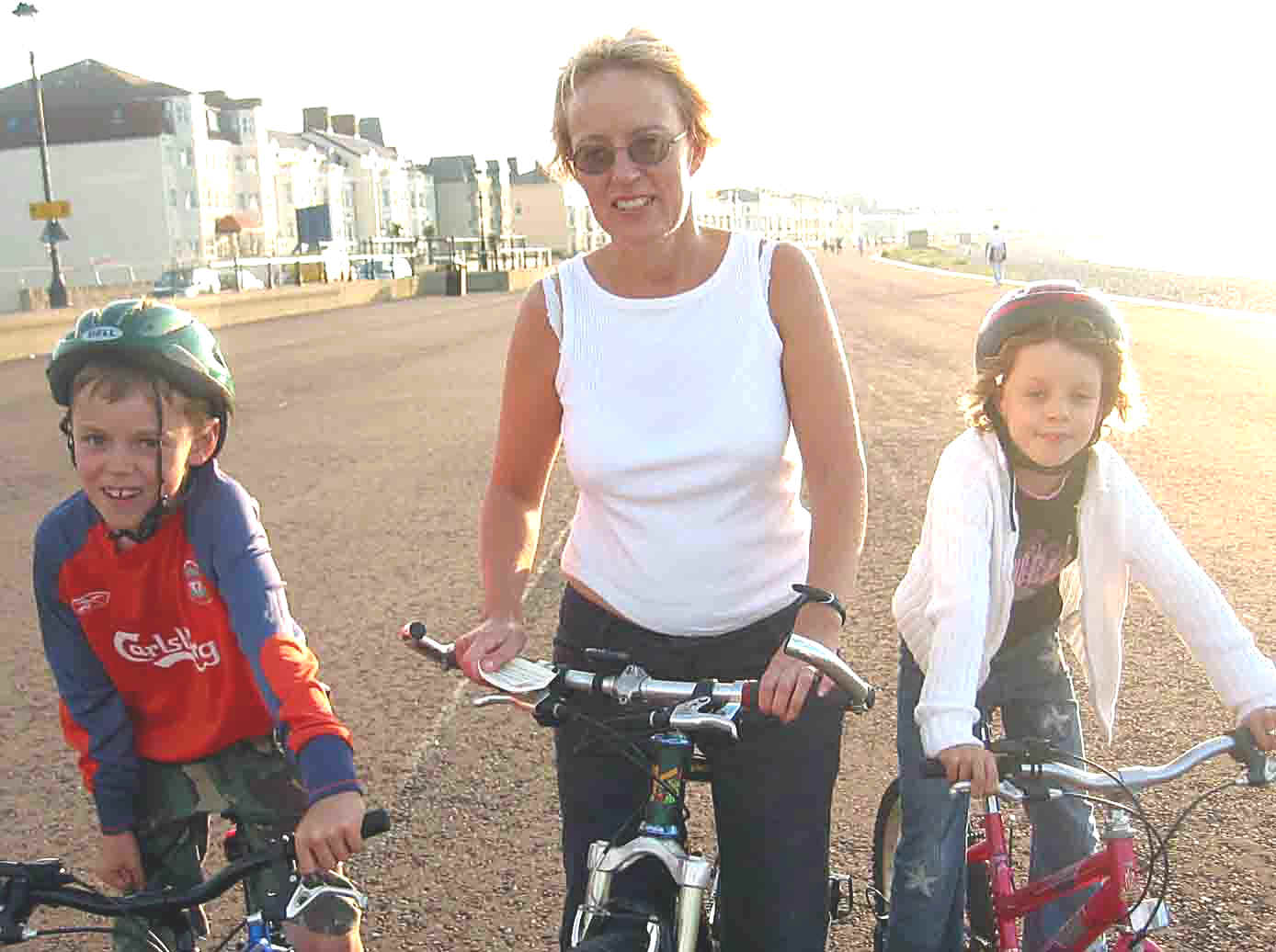 Mother and two young children on Llandudno promenade