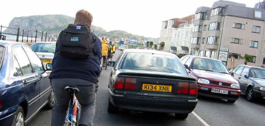 Cyclists among heavy traffic on Llandudno's seafront road