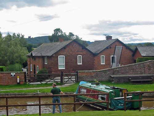 photo of Bate's Mill with the Shropshire Union canal and longboat in the foreground