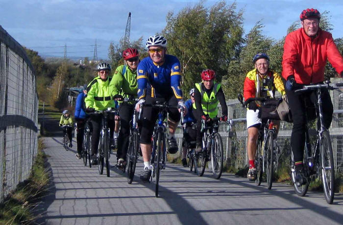 Photo of cyclists crossing bridge
