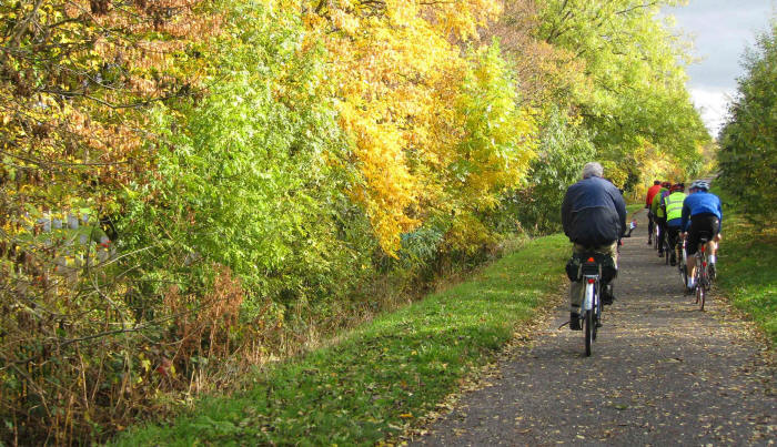 photo of cyclists on cycle path with autum colours